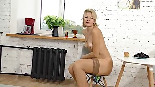 Golden blonde mature takes off her panties