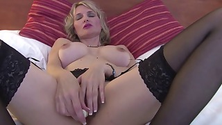 Cute busty mature plays with her snatch