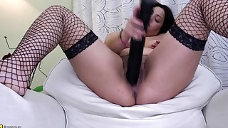 Passionate hairy mature fucks with a black toy