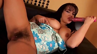 Soloing busty hairy mature gets naked