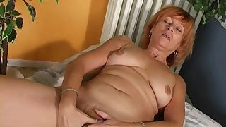 Redhead chubby hairy mature takes a toy