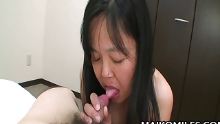 Cute-looking hairy Asian doll fucked by a toy