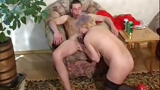 Hot Blonde mature jumps on a young boner