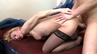 Good-looking blonde mature rides on a dick