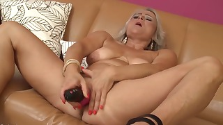 Stunning blonde mature plays with her pussy