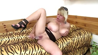 Lusty blonde MILF fucks with a dildo