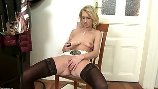 Cute blonde MILF is playing with a rubber dildo