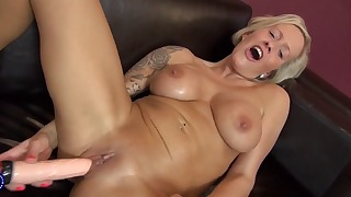 Sensual soloing busty blonde plays with a toy