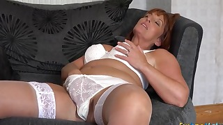 Cute redhead MILF shows off her body