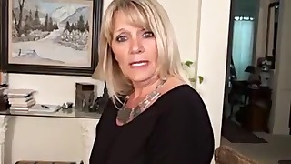 Gorgeous MILF mature plays with her pussy
