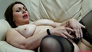 Glamorous busty hottie MILF plays with a dildo