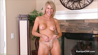Mature solo with a long black dildo