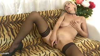 Beautiful blonde mature shows her pussy