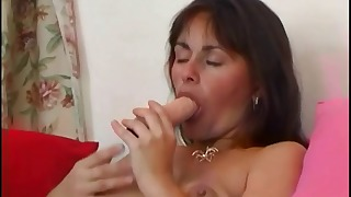 Cute brunette mature sucks her dildo
