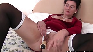 Sweet brunette mature fucks with a sex tool