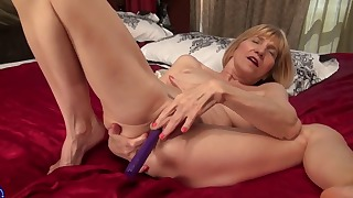 Good-looking mature blonde in solo action