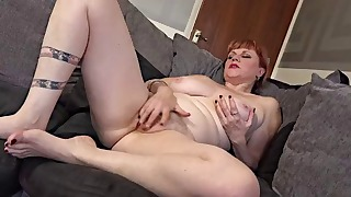 Good-looking soloing busty redhead mature