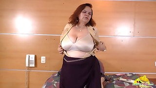 Passionate redhead Latina shows her naked tits